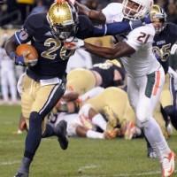 SportsLogos.Net Best/Worst 2012 college football NCAA worst uniform awards - Norte Dame RB