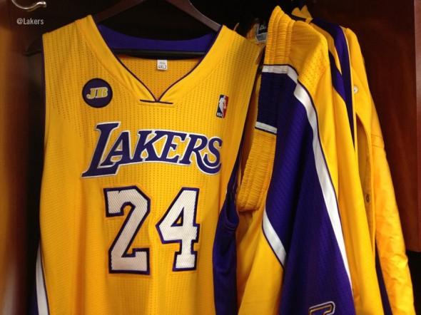 Jerseys hanging - LA Los Angeles Lakers Jerry Buss memorial patch jersey