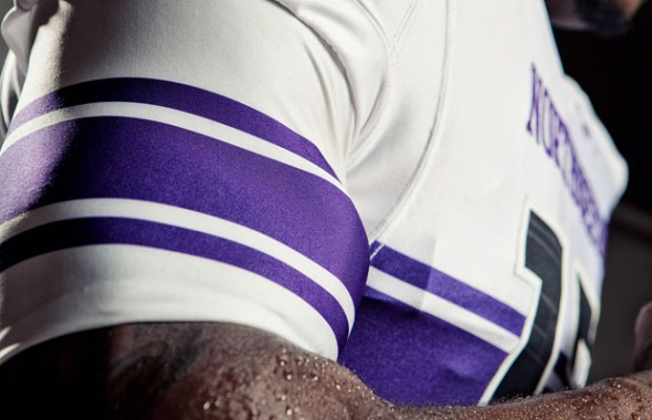 northwestern university new uniforms uni under armour wildcats white stripe detail