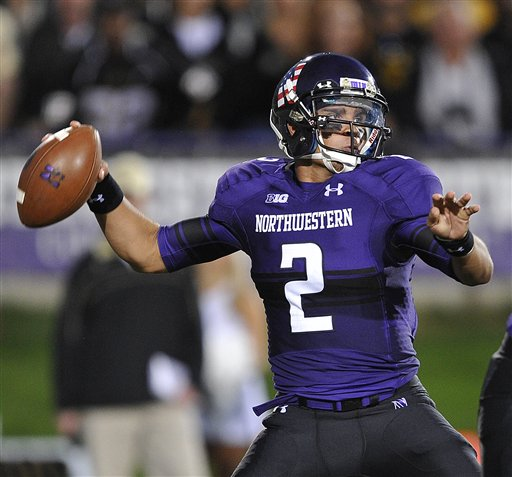 SportsLogos.Net Best/Worst 2012 college football NCAA best uniform - Northwestern purple black QB